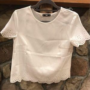 Super cute white top!